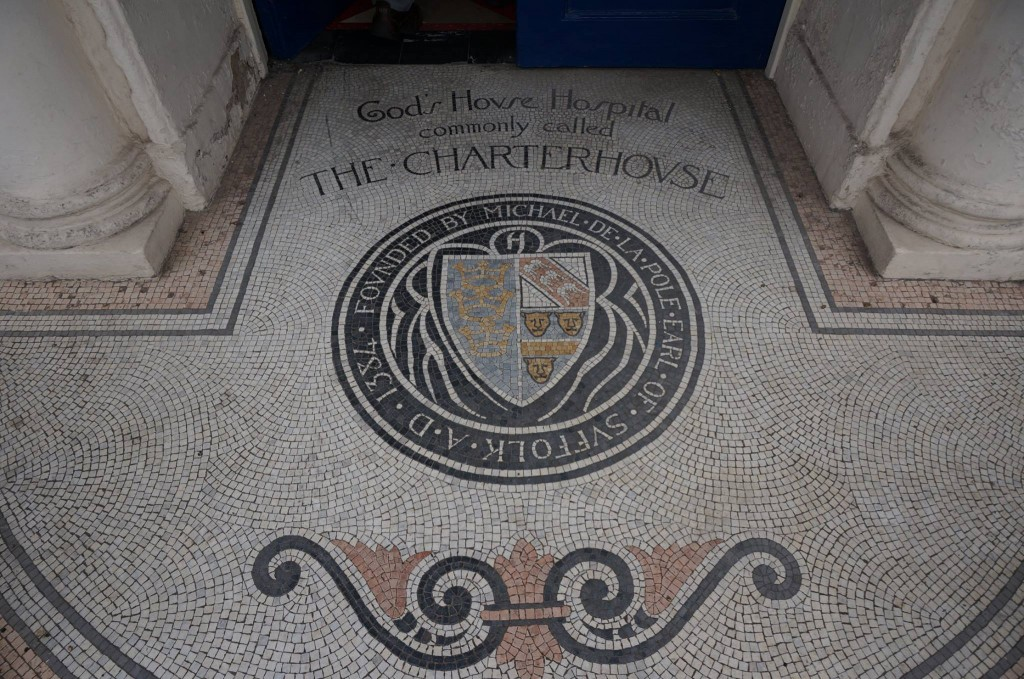 The mosaic on the doorstep of the front entrance.